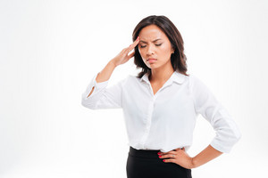 Portrait of a depressed tired asian businesswoman standing over white background