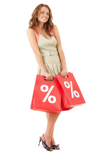 Portrait of a girl holding handbags with discount symbol