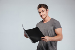 Portrait of a happy satisfied man holding folder over white background