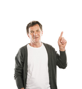 Portrait of a happy senior man pointing upwards isolated on white background