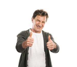 Portrait of a happy senior man with thumbs up isolated on white background