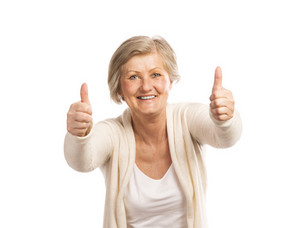 Portrait of a happy senior womanwith thumbs up isolated on white background