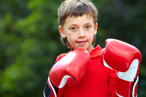 Portrait of a little boy in boxing gloves