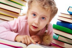 Portrait of a little girl among books