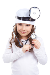 Portrait of a little girl in doctor uniform looking at camera, isolated on white