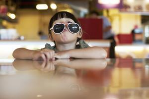 portrait of a pretty little girl wearing sunglasses
