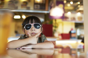 portrait of a pretty little girl wearing sunglasses