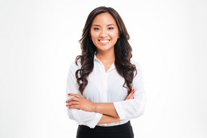 Portrait of a smiling asian businesswoman standing with arms folded isolated on a white background
