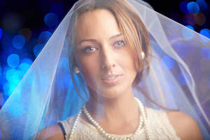 Portrait of a smiling bride in white veil