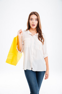 Portrait of a surprised woman holding shopping bag isolated on a white background