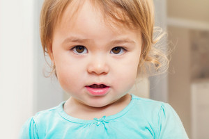 Portrait of a toddler girl her in house