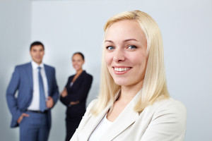 Portrait of a young woman looking at camera and smiling in office