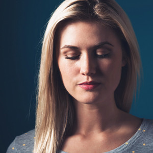 Portrait of a young woman on a dark blue background