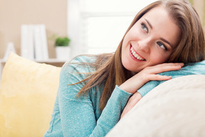 Portrait of a young woman smiling in her living room