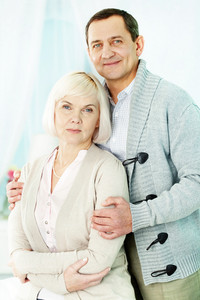 Portrait of affectionate senior couple looking at camera