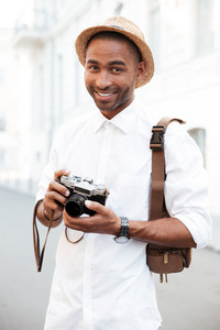 Portrait of afro american photographer. on the street. looking at camera
