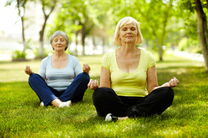 Portrait of aged women doing yoga exercise