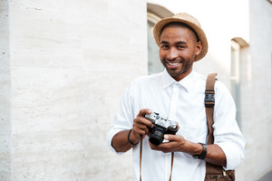 Portrait of an African male photographer. smiling. on the street