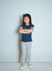 Portrait of angry young little Asian girl.