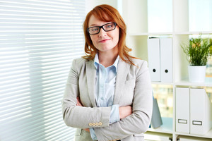 Portrait of attractive businesswoman looking at camera in office