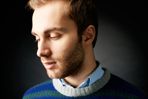 Portrait of attractive calm male in isolation