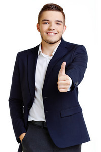 Portrait of attractive male in formalwear showing thumb up and looking at camera