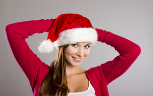 Portrait of attractive woman, studio shot in christmas hat