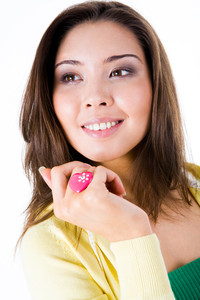 Portrait of beautiful Asian woman with pink heart-shaped ring on her finger