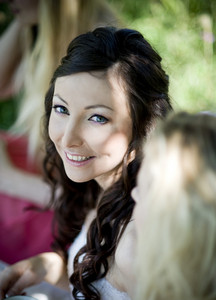 Portrait of beautiful brunette bride smiling and looking to camera
