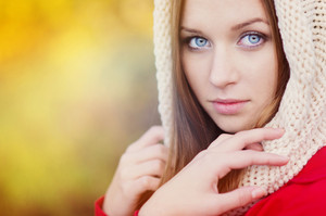Portrait of beautiful girl with scarf in autumn nature