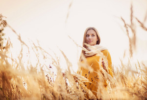 Portrait of beautiful girl with scarf in yellow autumn nature