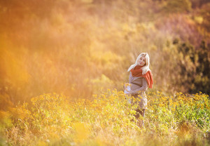 Portrait of beautiful pregnant woman in a field