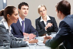 Portrait of business team interviewing man