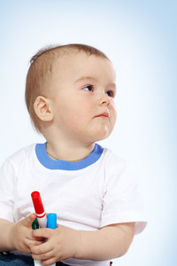 Portrait of calm child with crayons over white background