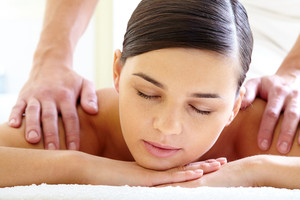 Portrait of calm female enjoying luxurious procedure of massage