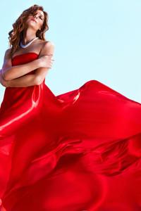 Portrait of charming female wearing elegant red dress