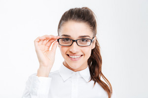 Portrait of cheerful attractive young businesswoman in glasses over white background