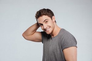 Portrait of cheerful attrative young man in t-shirt over white background