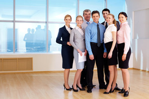 Portrait of confident business group standing next to each other and looking at camera