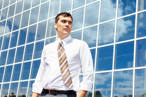Portrait of confident businessman on background of office building