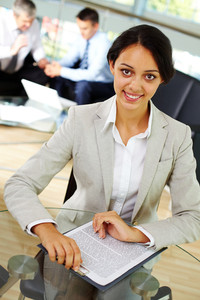 Portrait of confident female looking at camera in working environment
