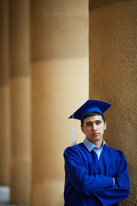 Portrait of confident graduation student looking at camera