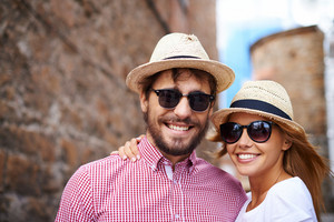 Portrait of couple in hats and sunglasses