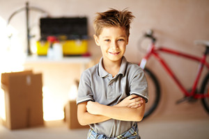 Portrait of cute boy looking at camera in garage
