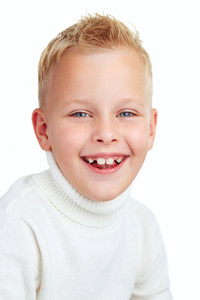 Portrait of cute boy smiling while looking at camera