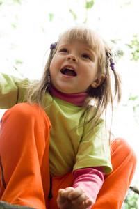 Portrait of cute girl having fun outside