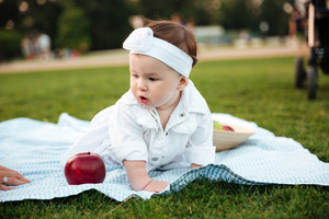 Portrait of cute little girl on picnic in park