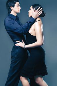 Portrait of elegant couple on black background
