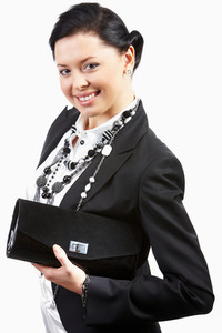 Portrait of fashionable businesswoman with handbag