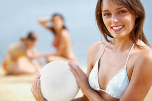 Portrait of fresh woman with ball looking at camera